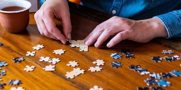 Building a jigsaw puzzle while staying at home during coronavirus lockdown